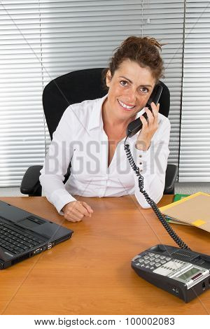 Middle Age Woman At Work In A Modern Office