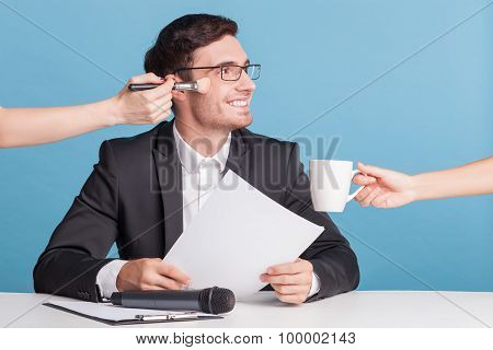 Handsome young reporter is preparing for his work