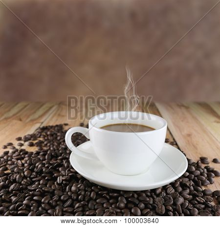 White Coffee Cup And Roasted Coffee Beans.