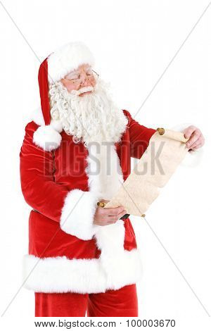 Santa Claus holding wish list, isolated on white background