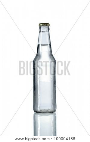 Glass bottled water on reflective table isolated over white background - With clipping path on bottle