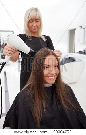 Attractive young girl is attending a beauty salon