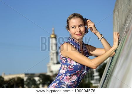 Young Beautiful Girl Standing Near The Concrete Wall