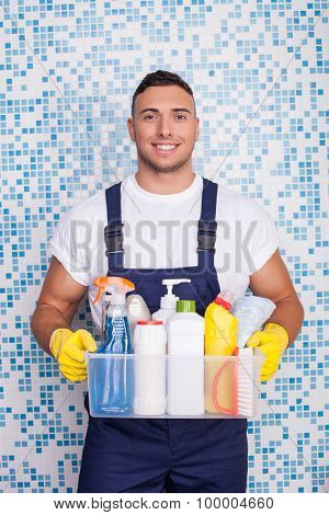 Attractive young stay-at-home man is cleaning his house