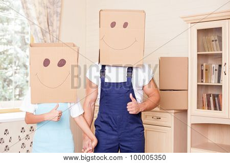 Pretty loving couple is moving in another apartment