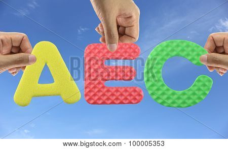 Hand arrange alphabet AEC of acronym ASEAN Economic Community in trade and investment. poster