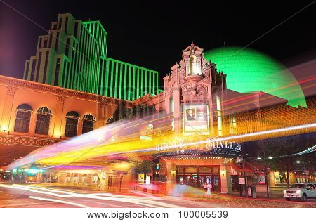 Reno, Usa - August 12: Silver Legacy Resort And Casino At Night With Moving Lights From Passing Traf