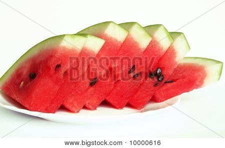 Slices Of Juicy Watermelon Served On White Plate