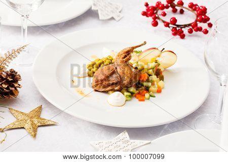 quail with salad on Christmas table