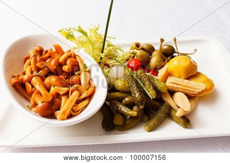 Set on a plate of pickles