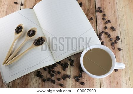 White Coffee Cup And Empty Book.