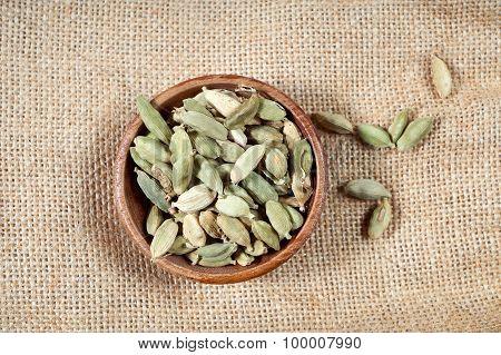 Cardamom In Wooden Bowl