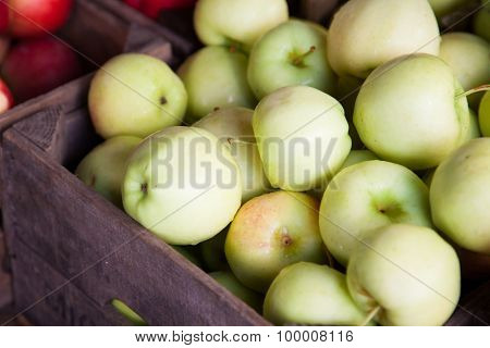 Box full of fine ripe green apples
