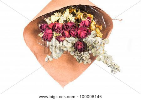 Bouquet Of Beautiful Wrapped Dried Red Roses And Flowers.