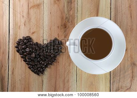 White Coffee Cup And Coffee Bean Are Heart Shape.