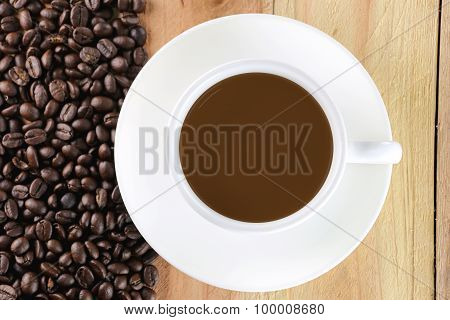 White Coffee Cup And Coffee Bean.