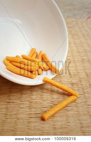 Bread Sticks On Background Of Brown Wood.