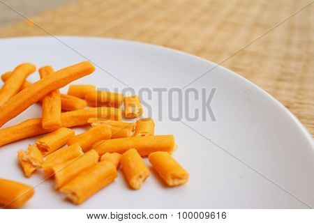 Bread Sticks In White Plate On A Table