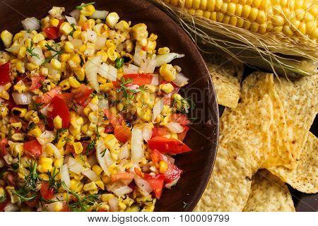 Corn salsa with onion and tomato