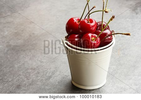 Red cherries in a white cup