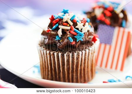 Chocolate cup cake with tricolor sprinkles