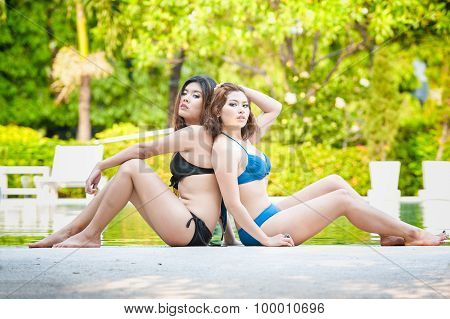 Portrait Two Asia Girls On Water Pool Border