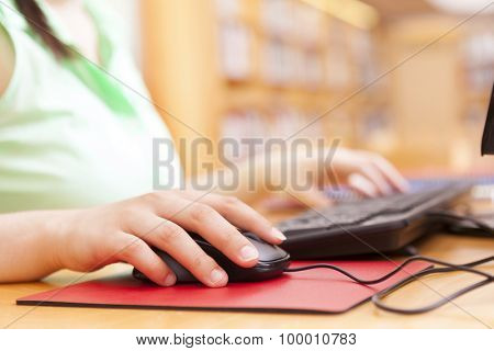 Close up of a woman using the computer at the university
