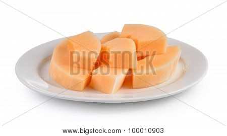 Sliced Cantaloupe Melon On White Plate On White Background