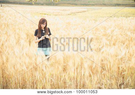 Portrait Of A Beautiful Glasses Woman In Barley Field.