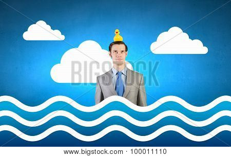 Businessman with yellow duck
