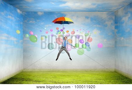 Man fly on umbrella