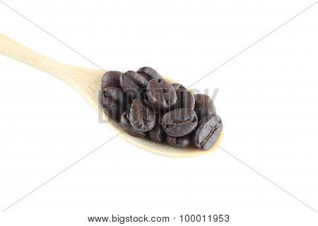 Coffee Beans In Wooden Spoon Isolated On White.
