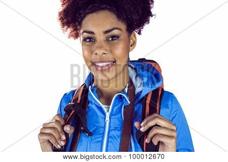 Close up view of a young woman with camera and backpack on a white background