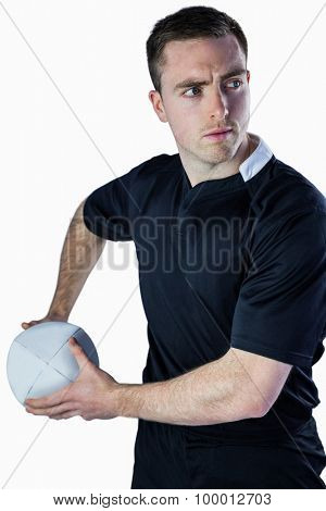 Rugbyman about to throw a rugby ball on a white background