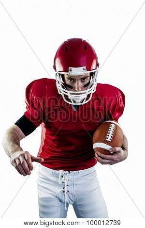 Portrait of focused american football player being ready to attack against white background