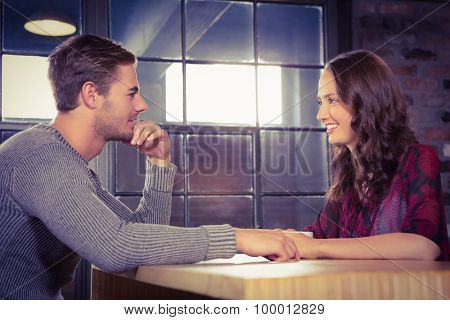 Smiling couple talking at coffee shop