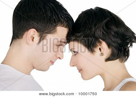 Profile Of A Smiling Young Couple In Love
