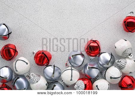 Jingle bells on silver background