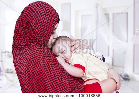 Mother With Veil Kiss Her Baby In Bedroom