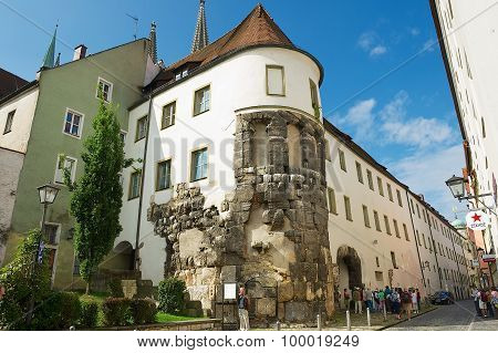 Tourists visit the remains of the East Tower of Porta Praetoria in Regensburg, Germany.