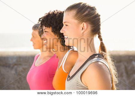 Smiling sporty women looking far away at promenade