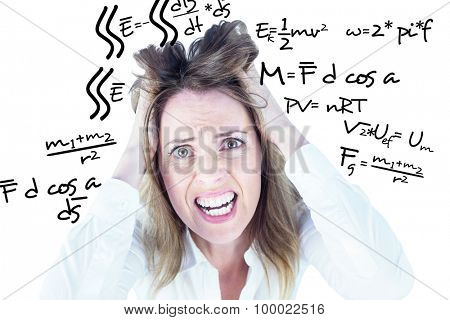 Stressed businesswoman with hands on her head against maths equation poster