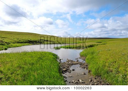 Landscape With Hills And A Stream