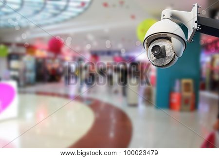 Closeup image of CCTV security camera outdoor in shopping mall poster