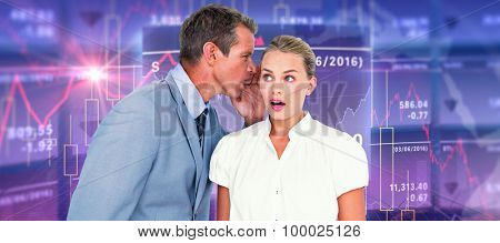 Businessman telling secret to a businesswoman against stocks and shares Businessman telling secret to a businesswoman against a white screen