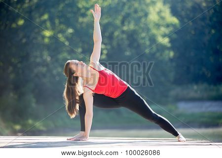 Teenage Girl In Extended Side Angle Pose