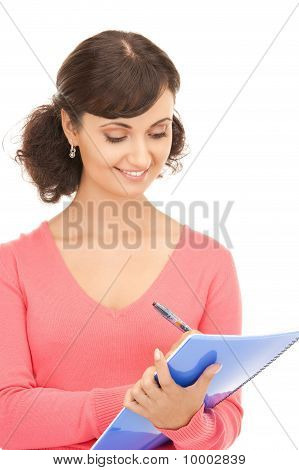 Young Attractive Businesswoman With Notebook