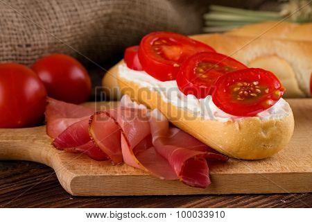 Slice Of Schwartzwald Ham Next To Baguette