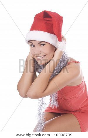 Portrait Of Beautiful Brunette Young Woman Wearing Santa Claus Hat