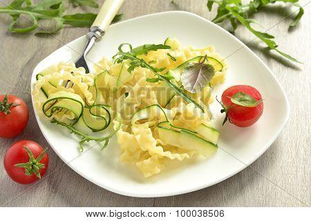 Italian pasta noodles with zucchini, arugula, basil